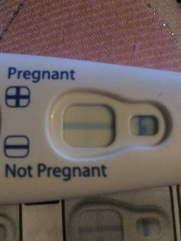 Very very faint line on clear blue test, am I pregnant?